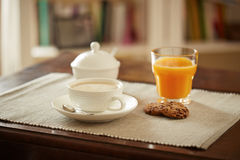 Breakfast table with juice, coffe and cookies Stock Photography
