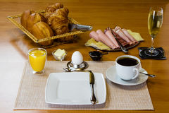 Breakfast table. Large breakfast with sparkling wine , orange juice and egg Royalty Free Stock Photography