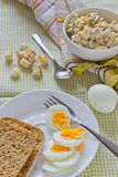 Breakfast on the table. Light breakfast of boiled eggs and salad Royalty Free Stock Photo
