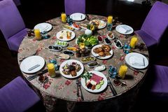 Breakfast table. Luxury and rich foods like orange juices. Cakes and also some desserts stock photography