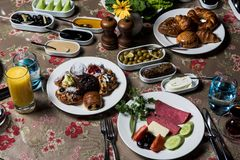 Breakfast table. Luxury and rich foods like orange juices. Cakes and also some desserts stock photos