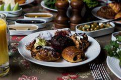Breakfast table. Luxury and rich foods like patties. Cakes and also some desserts stock image