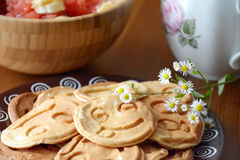 Breakfast table: pancakes, fruit salad and chamomile flowers Royalty Free Stock Photos
