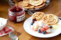 Breakfast table: pancakes, fruit salad, jam, yogurt Stock Photo