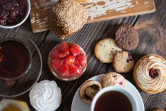 Breakfast table with pastries Stock Images