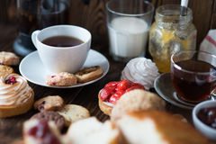 Breakfast table with pastries Stock Photos