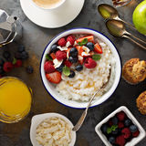 Breakfast table with rice pudding, fruit and muffins Royalty Free Stock Image