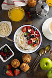Breakfast table with rice pudding, fruit and muffins Royalty Free Stock Images