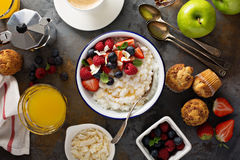 Breakfast table with rice pudding, fruit and muffins Stock Photo