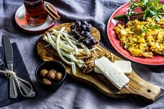 Breakfast Table Scene with eggs. Lifestyle,Cooking. Breakfast table with cheese, grapes, tea, egg and walnut. Top view,closeup Stock Photography