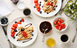 Breakfast table set with crepes Royalty Free Stock Images
