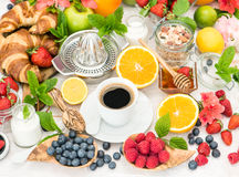 Breakfast table setting with coffee, croissants, granola. Health Stock Image