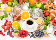 Breakfast table setting with coffee, croissants, granola. Health Stock Images
