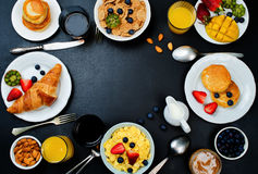 Breakfast table setting with flakes, juice, croissants, pancakes. And fresh berries. toning. selective focus royalty free stock photos