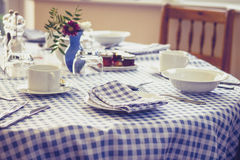 Breakfast table on sunny morning Royalty Free Stock Photo