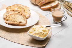 Breakfast table with toast. Breakfast table with bread toast with butter and milk with coffee Stock Image