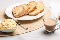 Breakfast table with toast. Breakfast table with bread toast with butter and milk with coffee Royalty Free Stock Images