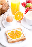 Breakfast table with toast and orange marmelade  Royalty Free Stock Photos