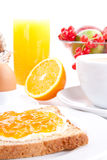 Breakfast table with toast and orange marmelade  Stock Images