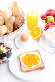 Breakfast table with toast and orange marmelade  Stock Photography