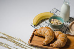 Breakfast table with yummy Croissant and Cereal and banana and fresh milk Stock Image