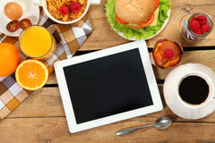 Breakfast and tablet Stock Images