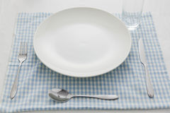 Breakfast tableware. Clean breakfast tableware on table mat in white background Royalty Free Stock Images