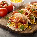 Breakfast tacos with scrambled eggs and bacon stock images