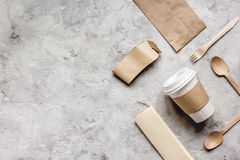 Breakfast take away with paper bags on gray table background top view mock up Stock Images