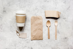 Breakfast take away with paper bags on gray table background top view mock up Royalty Free Stock Photo