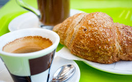 Breakfast. A tasty breakfast with coffee, cappuccino and biosche royalty free stock photography