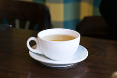 Breakfast tea in a cafe.Cup on a table Stock Photos