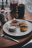 Breakfast with tea, coffee, sandwiches and cheesecakes in a cafe Royalty Free Stock Photography