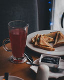 Breakfast with tea, coffee, sandwiches and cheesecakes in a cafe Royalty Free Stock Images