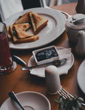 Breakfast with tea, coffee, sandwiches and cheesecakes in a cafe Stock Images