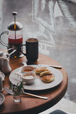 Breakfast with tea, coffee, sandwiches and cheesecakes in a cafe Royalty Free Stock Photos