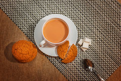 Breakfast. Tea composition of black tea with milk, oatmeal cookies, sugar, healthy Breakfast royalty free stock photos
