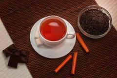 Breakfast. Tea composition of black tea, sugar, healthy Breakfast, cinnamon, dark chocolate Stock Photography