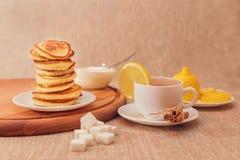 Breakfast. Tea composition of black tea, sugar, healthy Breakfast, cinnamon, lemon, citrus Royalty Free Stock Image