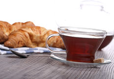 Breakfast with tea and croissant Royalty Free Stock Images