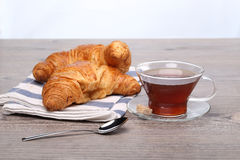 Breakfast with tea and croissant Royalty Free Stock Photos