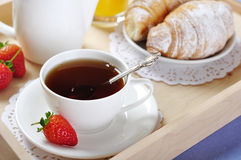 Breakfast with tea and croissants Stock Images