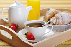 Breakfast with tea and croissants Royalty Free Stock Photo