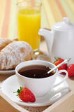 Breakfast with tea and croissants Royalty Free Stock Image