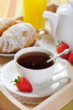Breakfast with tea and croissants Stock Photo