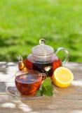 Breakfast tea on garden table Stock Photo
