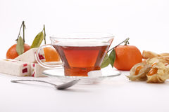 Breakfast with tea, mandarin and physalis. Breakfast with tea, mandarin orange and physalis Royalty Free Stock Images