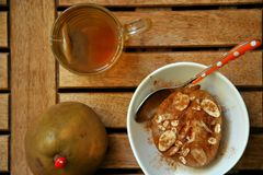 Breakfast with tea and poached pear Stock Photo