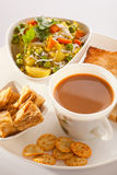 Breakfast - Tea, Poha with bread and Biscuit. Stock Images