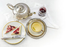 Breakfast with tea, sandwich and jam on white marble as a corner Royalty Free Stock Image
